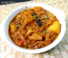 Cabbage and potato stir fried and cooked in mildly spiced tomato gravy    Today I am posting my children's favourite potato cabbage curr...