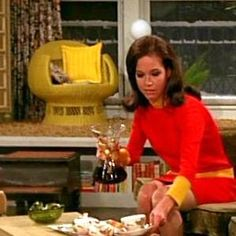 Mary drinking coffee in a killer red dress in her sick apartment | Mary Tyler Moore