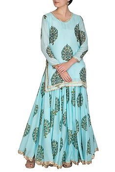 Featuring a blue short kurta in muslin and shantoon base with gota lines and blue block print. It is paired with matching lehenga skirt having scallop lace border. FIT: Fitted at bust and waist. CARE: Dry clean only. Gharara Designs, Choli Designs, Kurta Designs, Blouse Designs, Lehenga Skirt, Lehenga Choli, Blue Block, Indian Fashion Designers, Pernia Pop Up Shop
