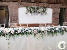Top table garland and hanging flower backdrop - Rustic wedding flowers - Owen House Barn - Dusky pink and pale blue
