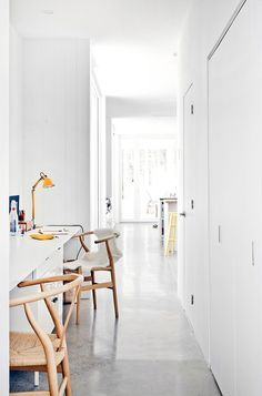 Bright white office with yellow desk lamp