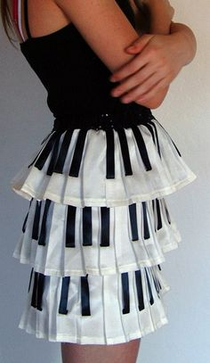 Piano skirt. It seems that the black keys are made of black ribbon.