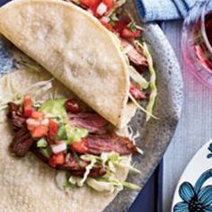 Top these spicy skirt steak tacos from the brothers behind Brooklyn's Calexico with avocado salsa and pico de gallo for dinner tonight! A recipe from Food & Wine. Find these and more steak tacos at www.edamam.com!