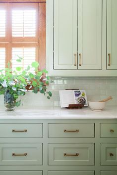 If you're looking for something different than the typical white or gray kitchen cabinets, consider soft sage. The subtle hint of color looks great with wood tones, stainless steel and various types of stone.