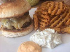 Wagyu burger, monetary Jack, bourbon glazed bacon, burger sauce and pickles. Waffle fries & onion rings