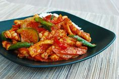This squid dish is one of the most popular spicy dishes in Korean cuisine. The squid is cut into bite-sized pieces and stir fried in a slightly sweet red chili sauce along with some vegetables. The sauce's main ingredients are gochujang (fermented chili pepper paste) and gochugaru (chili pepper flakes). For an authentic dish, there …