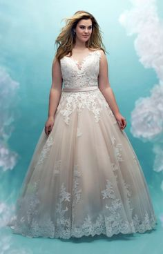 Allure Bridals is the plus size wedding gown you've been dreaming of! This tulle ball gown is complete with an illusion neckline, lace appliques, and a satin sash. Tulle Ball Gown, Ball Gowns, Tulle Balls, Bridal Dresses, Bridesmaid Dresses, Dress Wedding, Ivory Wedding, Plus Size Wedding Gowns, Wedding Dresses For Curvy Women