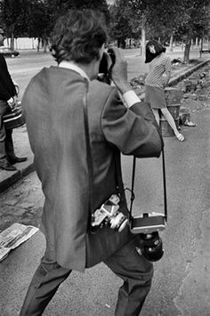 On the set of Made in USA, Jean-Luc Godard takes a picture of Anna Karina, 1967