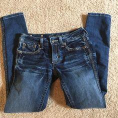 Miss Me jeans NWOT Trim on side, embellished pockets. Never worn. Miss Me Jeans Skinny