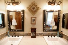 Bathroom vanity with his/her sinks and mirrors