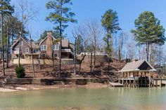 Spectacular 6 BR home on Lake Martin. No expense spared on finishes & details..fine granites, woodwork, high ceilings, elegant light fixtures & more. Open floor plan in main living area, 2 living areas, 2 fireplaces, huge screened porch, + lg patio overlooking lake w/3rd fireplace and fountain. Golf cart path to the lake, boathouse, pier, dive platform.  Damon Story, 205-789-9526, Lake Martin Realty. Photos & tour by Sherry Watkins…I Shoot…