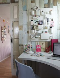 office space by back entry? LOVE the inverted curve on the desktop... and the accent wall behind.