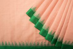 Lovely peach Khadi cotton saree with a contrasting green temple border