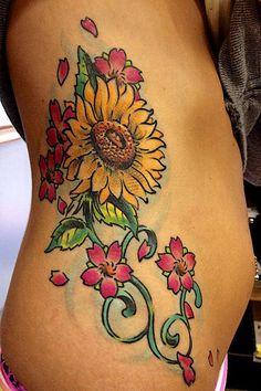 Image from http://extendcreative.com/wp-content/uploads/2014/07/Ribs-Sunflower-Tattoo-Design-Ideas-For-Women.jpg.