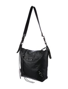 Black Arena leather Balenciaga Motocross Classic Day bag with silver-tone hardware, single flat shoulder strap, buckle and stud accents throughout, single exterior zip pocket, tonal woven lining, single interior zip pocket and zip closure at top. Shop Balenciaga consignment handbags at The RealReal.
