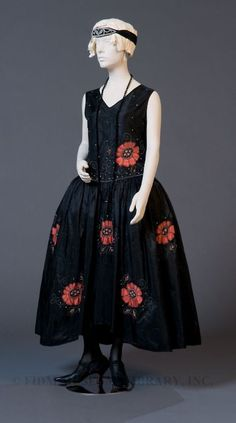 "Robe de style  c.1923  Gift of Ms. Sandra Coleman  S2005.851.1    ""The construction of the robe de style is quite straightforward, as the silhouette does not require careful fitting and shaping of the garment. Visual interest is created by the appliqued flowers of pink silk. The flowers are accentuated by leaves and trailing vines made of clear beads and chenille thread. The bodice is dotted with numerous applied faux crystals. This type of ornamentation is very typical of the robe de style…"