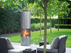 22 Modern Fireplaces Bringing Magic Warmth into Stylish Outdoor Rooms - A modern fireplace design brings style and chic into outdoor rooms, transforms yard landscaping and creates beautiful, warm and cozy patios - Tropical Garden Design, Modern Garden Design, Contemporary Garden, Modern Design, Outdoor Seating Areas, Outdoor Rooms, Outdoor Wood Fireplace, Outdoor Fireplaces, Contemporary Fireplace Designs