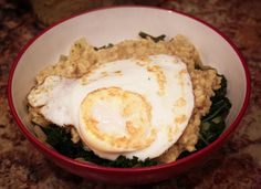 Over easy savory oatmeal with kale... kale, onions, olive (or coconut oil), oats, egg, sauce of choice, nutritional yeast or cheese of choice
