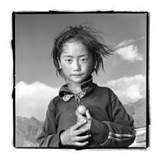 """Yama 8, Lhasa, Tibet by Phil Borges Yama accompanied her parents and three sisters on a 6 week pilgrimage to the Jokhang Temple in Lhasa from the province of Kham. """"Yama helped carry our 10 month old daughter much of the way."""" Her father said. """"We noticed very early that she was born with the true spirit of wanting to help others."""""""