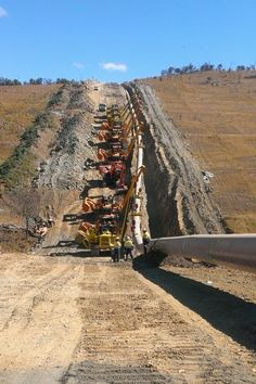 Up and down the hills, doesn't matter. The pipe must be laid.