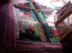 Scrappy (aren't they all?) log cabin lap quilt. SOLD.
