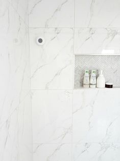 Design a Gorgeous Marble Shower (on a budget!)A marble shower featuring matte black faucet. Get this modern Design a Gorgeous Marble Shower (on a budget!) A marble shower featuring matte black faucet. Get this modern Carrara Marble Bathroom, Marble Look Tile, White Marble Bathrooms, Marble Showers, Tile Shower Niche, Bathroom Niche, Marble Tile Shower, Bathroom Updates, Shower Faucet