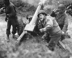 American howitzers shell German forces retreating near Carentan, France. July 11, 1944. Franklin. (Army)
