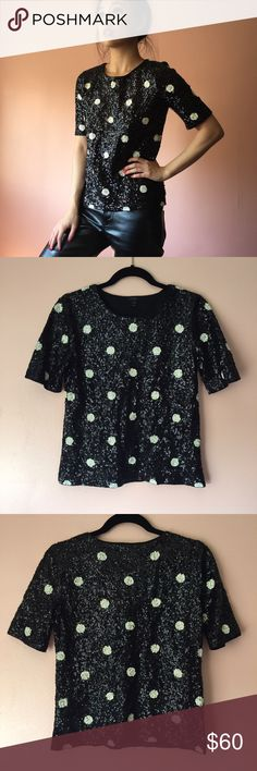 JCrew Sequin Polka Dot Top When you mix up the holiday dressing, slip on this polka dot sequin top by J.Crew. Features a crew neck, half sleeves, fully sequined white polka dot on black background and t-shirt silhouette. Wear with black leather skinnies. MSRP $145. Fits true to size XS. No returns allowed. Please ask all questions before buying. IG: [at] jacqueline.pak #jcrew J. Crew Tops
