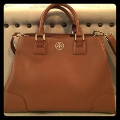 Tory Burch Robinson Triangle Tote in luggage Authentic gently used Tory Burch handbag with a shoulder strap. Leather is in great condition, no flaws on outside at all. Inside bottom has a few light stains that can be cleaned. Bought directly from ToryBurch.com Tory Burch Bags Totes
