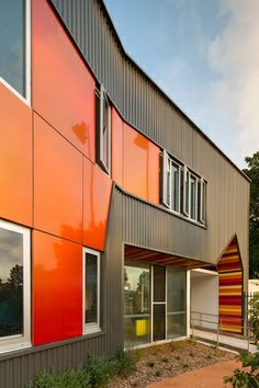 Vibrant red Alucobond panelling around the windows offers changing colour effects.