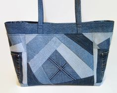 Tote bag, handbag or shoulder bag/purse made out of a variety of upcycled recycled repurposed denim blue jeans and cotton fabric was used to create this unique Crazy Quilt bag. This medium size bag is perfect for carrying all your daily needs, books, magazines or projects. Add a favorite pin to coordinate with your outfit. The front and back exterior denim pieces have been uniquely pieced together Crazy Quilt patchwork style differently which gives each side an original appearance. This ...
