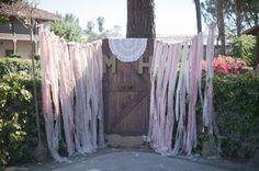 altar of ribbon garland and an old barn door!