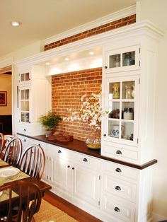 built in dining room hutch and cabinets with exposed stone.