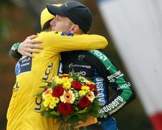 Teammates Alberto Contador and Levi Leipheimer (Discovery Channel) embrace after taking first and third in the 2007 Tour.