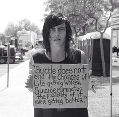 "Kellin Quinn holding the ""Suicide Sign"""