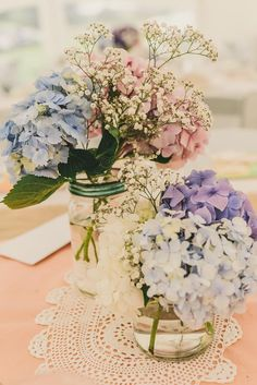 Gemma and John had a vintage / country themed wedding, with a pastel and gold colour scheme. They used gypsophila and coloured hydrangeas both outside and on all of the tables. Gemma had collected a ton of jars throughout the year to hold the flowers on the big day. Gemma and her mother also spent the year collecting doilies from op shops and sewing them into long strips of bunting to hang inside the marquee.  A Wanaka Wedding (www.awanakawedding.co.nz).