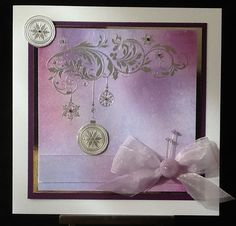 Distress ink background and Bauble Flourish stamp and silver embossing powder
