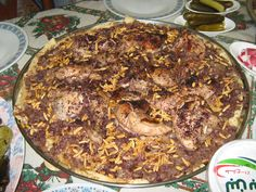 "Reteta culinara ""Musakhan""-Pui ""reincalzit"" cu ceapa si ""sumac""- palestiniana din categoria Pui. Specific Iordania. Cum sa faci ""Musakhan""-Pui ""reincalzit"" cu ceapa si ""sumac""-reteta palestiniana Tzatziki, Salads"