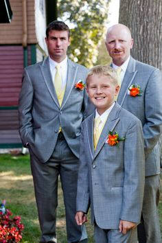 Grey Tuxedos are great options for day weddings - I don't like the red flowers though