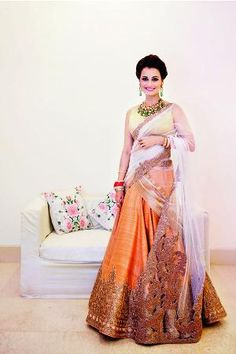 Dia Mirza and Sahil Sangha exchanged their wedding vows on Saturday in Delhi. At the post-wedding reception, Dia looked resplendent in a peach lehenga by designer duo and couturiers Shantanu & Nikhil - on trend bride - Indian bride - celebrity bride - Indian wedding - Indian couture #thecrimsonbride