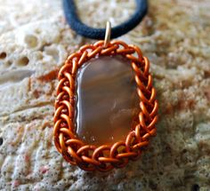 Carnelian Healing Stone Pendant Wrapped in by GeekyGaeaDesigns