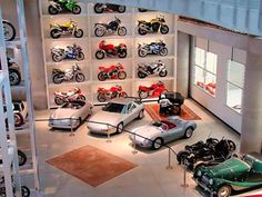 Great car and motorcycle garage in one. Wonderful way to display the motorcycles.