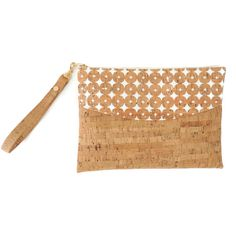 This vegan clutch bag is made from eco friendly, real cork fabric. Cork is a perfect material for a bag or a purse as it is naturally water and stain