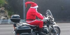 Santa...on a Guzzi!    Santa must have given up his reindeer to take on Auckland's Northwestern Motorway on Saturday, says Katrina Williams. Photo / Supplied