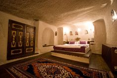 History of human habitation in the many caves of Turkey's Cappadocia region,& Gamirasu Cave Hotel– restored 30-room complex that formerly housed prison cells & a 1000-year-old monastic retreat–continues the trend.rOpened 1999,with 7 lovingly restored cave houses combined & used to make rooms providing comforts of modern hotel while staying faithful to natural surroundings.Rock walls also ensure cool temperatures in summer & warmth in winter