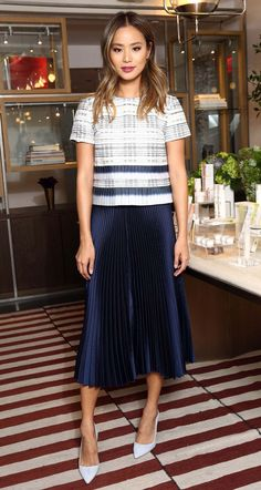 Jamie Chung in a pleated plaid top and pleated navy midi skirt - click through for more celebrity outfit ideas!