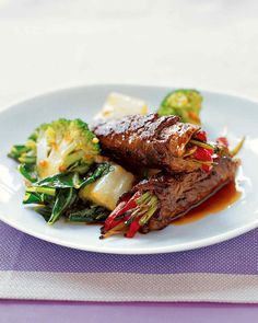Beef and Scallion Rolls | Martha Stewart Living - These Asian-influenced rolls combine tender, smoky sirloin, charred bell peppers, crunchy scallion slices, and a sweet soy pan sauce that brings the flavors together.