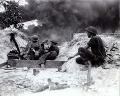 Vickers machine gun from the 18-th Infantry Brigade of the Australian 7th Division 7 firing on Japanese near Balikpapan on the island of Borneo 2nd July 1945 (Dutch East-India, Indonesia).