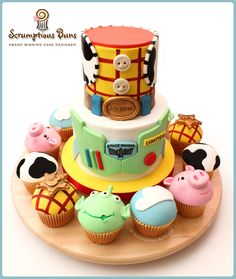 Toy story small tiered cake and coordinating cupcakes