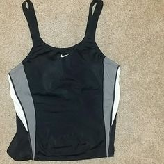 Nike swim workout crop top Purchased from another posher. Way too tiny for my boobs thought another posher might be interested.  Has built in bra with cups Nike Tops Crop Tops